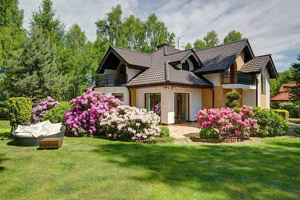 beautiful village house with garden - house with flowers stock photos and pictures