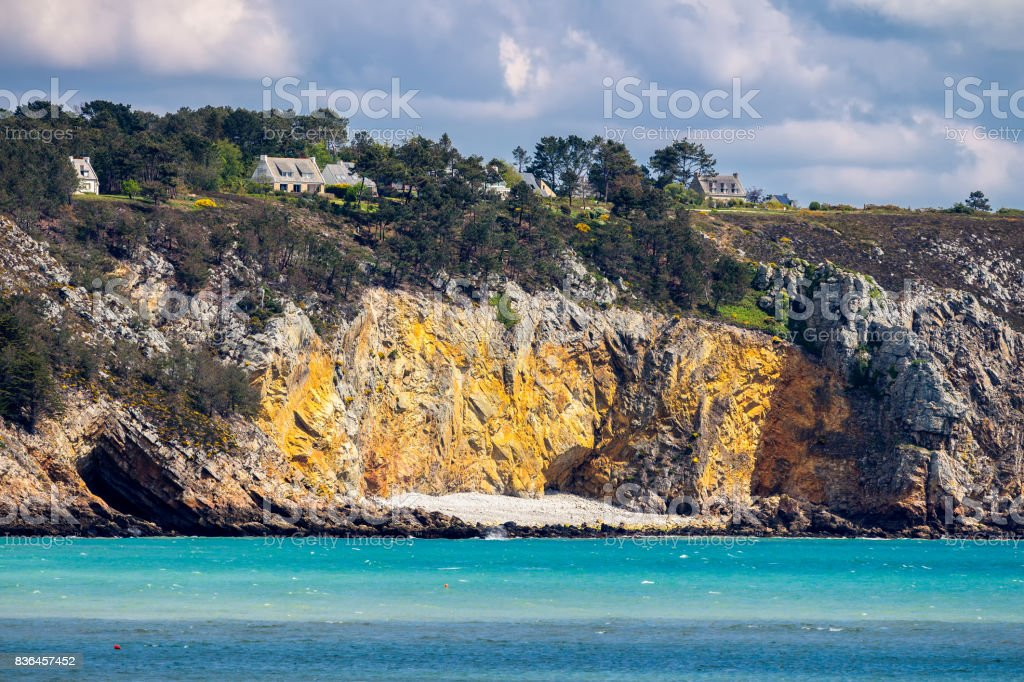 Beautiful village of Morgat with the sand beach and rocky coastline, Finistere, Brittany (Bretagne), France. stock photo