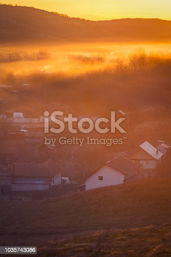 1034754000 istock photo Beautiful village scene in the morning with fog in the background 1035743086