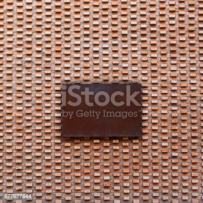 istock Beautiful vintage brick wall with rusty metal sign 577627644