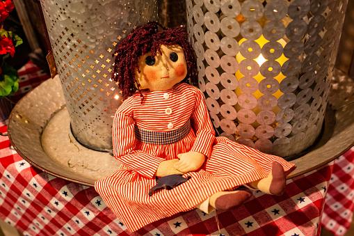 Beautiful vintage female doll closeup on shelf