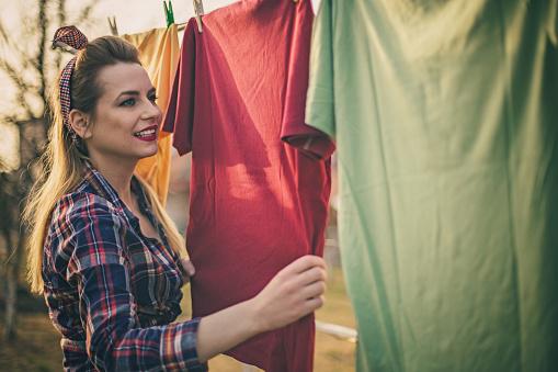 Beautiful vintage girl doing laundry