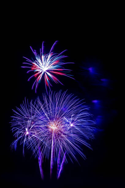 beautiful violet blue firework isolated display for celebration happy new year and merry christmas on black isolated background, fireworks new year stock photo