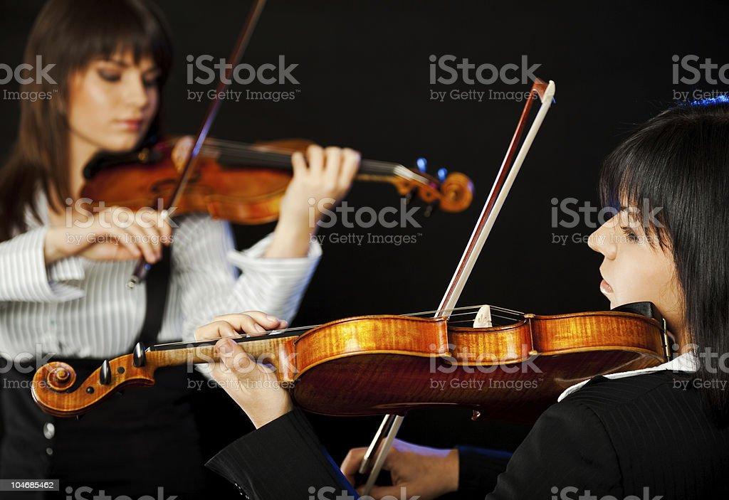 Beautiful violinists stock photo