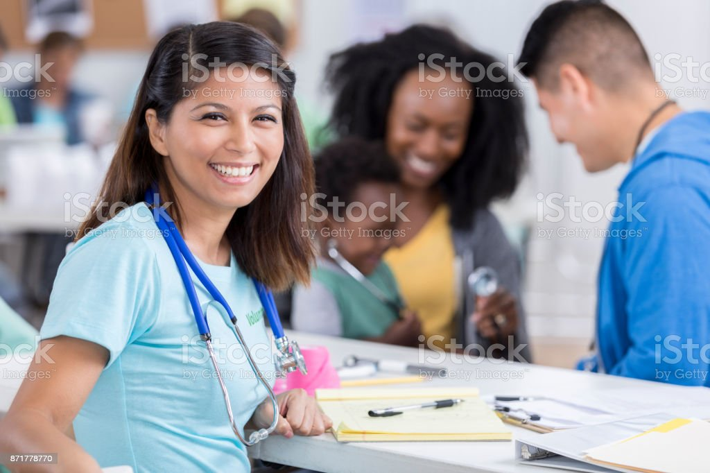 Beautiful volunteer healthcare worker smiles for camera stock photo