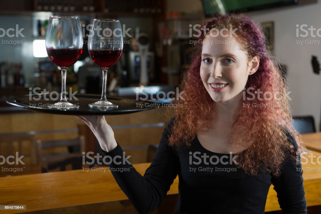 Beautiful Waitress Holding Wine Glasses Stock Photo - Download Image Now