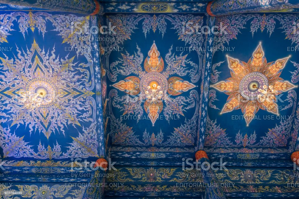 Beautiful wall and ceiling paintings in thai fine art pattern at Wat Rong Suea Ten Temple, locate at Chiang Rai province, northern part of Thailand. stock photo