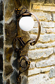 Beautiful wall lamp with wrought iron elements