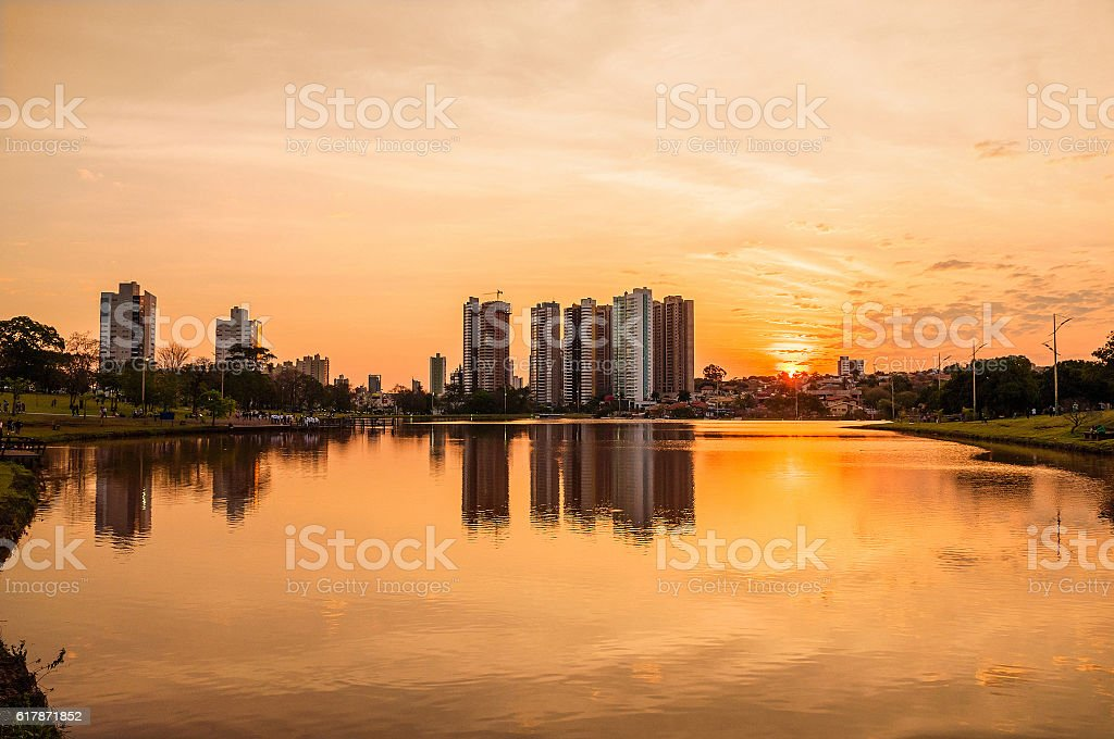 Beautiful warm sunset at the lake with buildings reflected stock photo