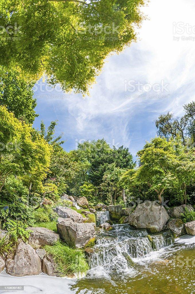 Beautiful Waterfall In A Scenic Garden royalty-free stock photo