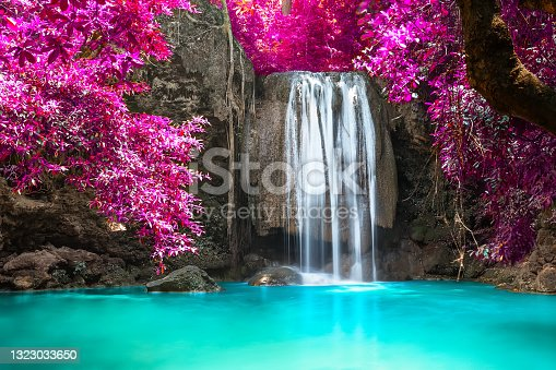 istock Beautiful waterfall in forest at Erawan National Park in Thailand. 1323033650