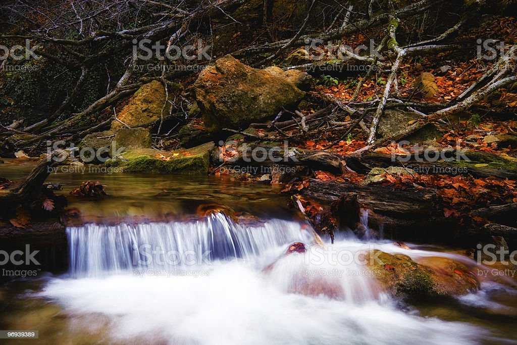 Beautiful waterfall in forest, autumn royalty-free stock photo