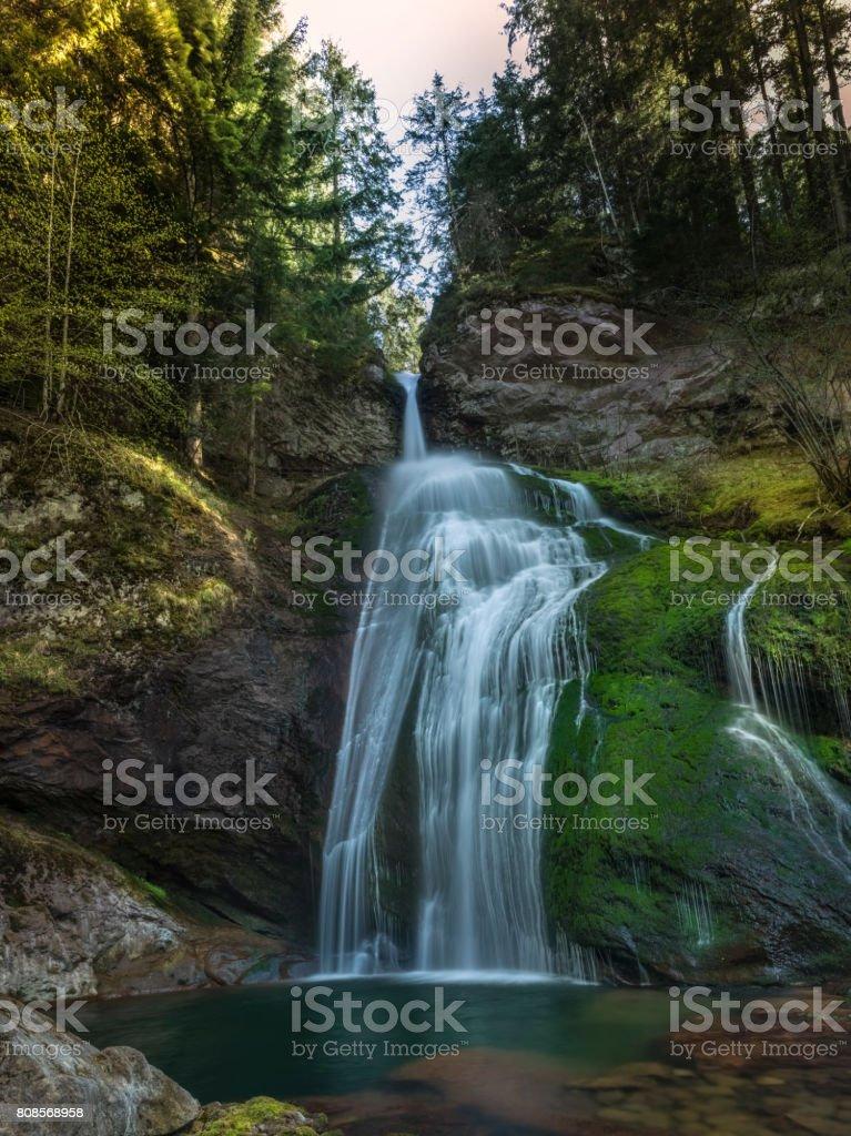 Beautiful waterfall in the Dolomites stock photo