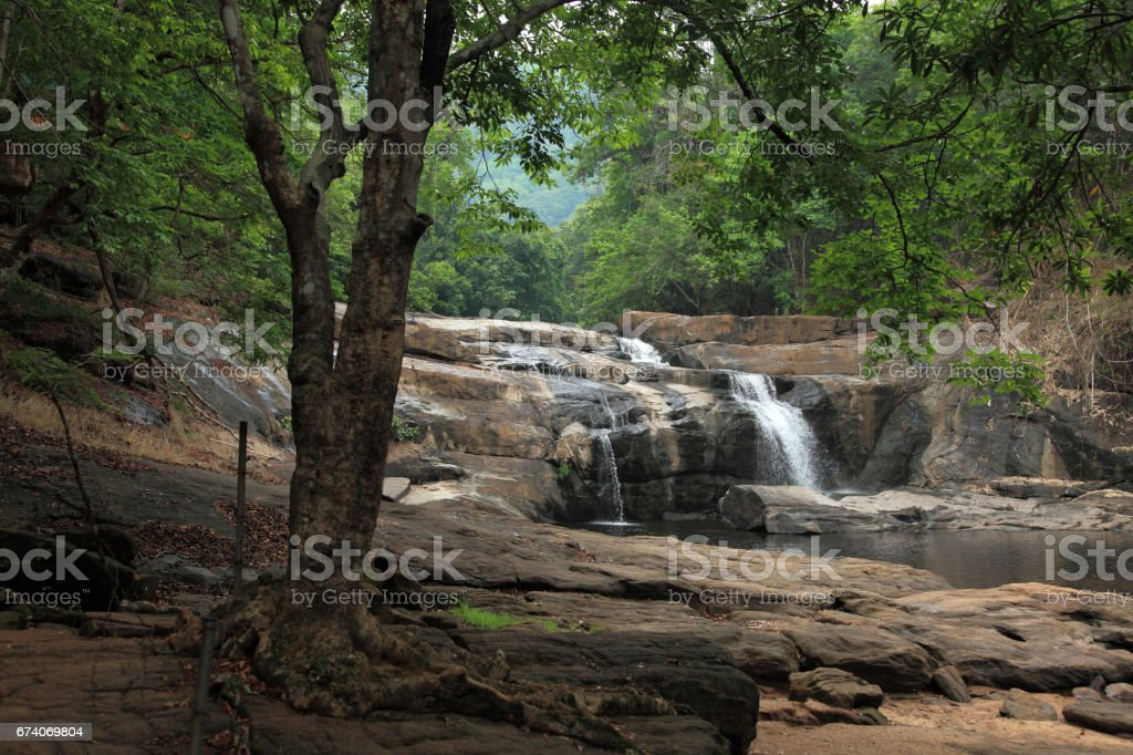A beautiful waterfall on a rocky mountain royalty-free stock photo
