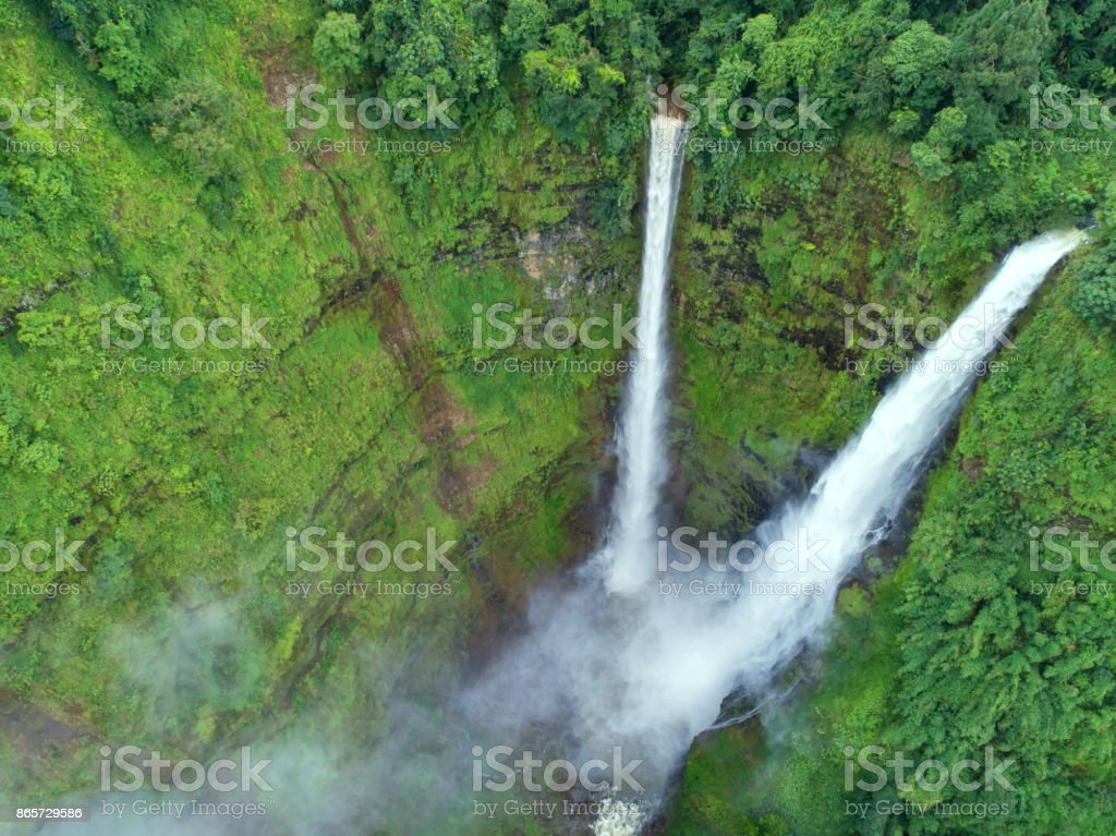 Beautiful waterfall.Tad Fan Waterfall in southern Laos.It is a place to visit the natural beauty.Mountain forest waterfall landscape.Top view,Aerial view,waterfall amazing nature background,Rainforest stock photo