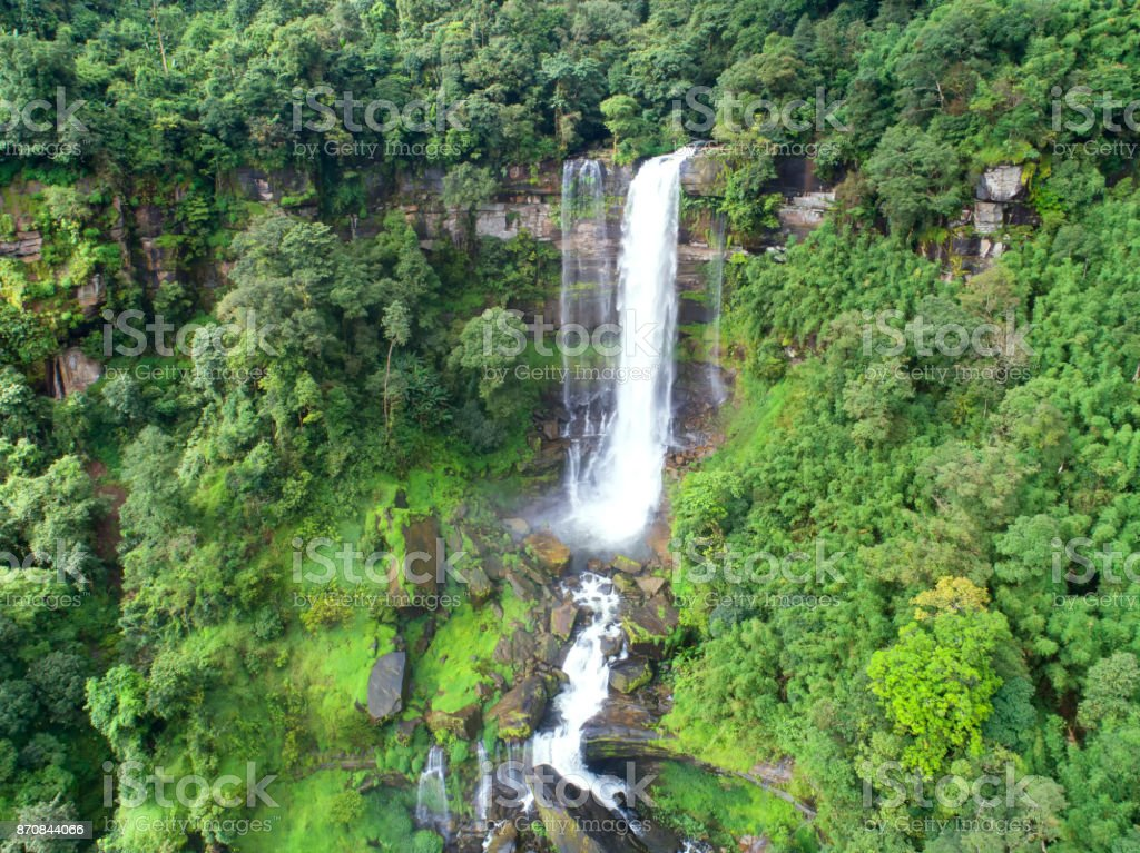 Beautiful waterfall.Tad Khamued Waterfall in southern Laos.It is a place to visit the natural beauty.Mountain forest waterfall landscape.Top view,Aerial view,waterfall amazing nature background,Rainfores stock photo