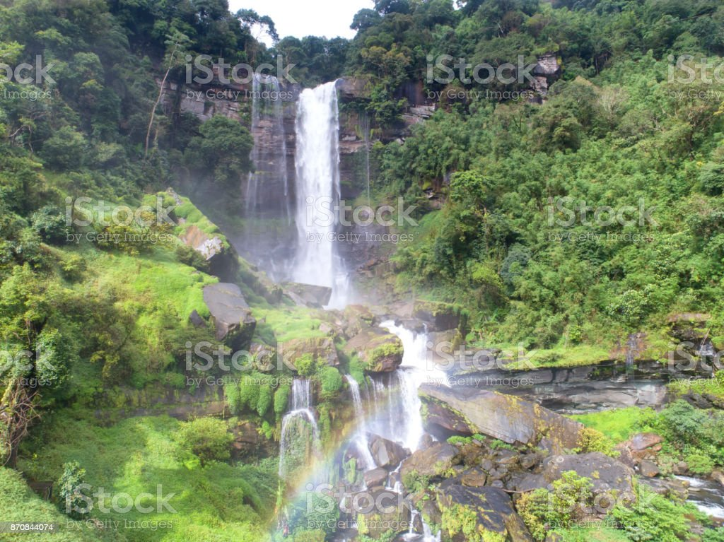 Beautiful waterfall.Tad Khamued Waterfall in southern Laos.It is a place to visit the natural beauty.Mountain forest waterfall landscape.Top view,Aerial view,waterfall amazing nature background,Rainforest stock photo