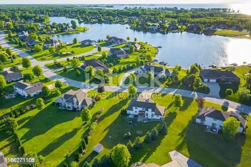 istock Beautiful Waterfront Homes On Lake At Sunrise In Summertime. 1166271108