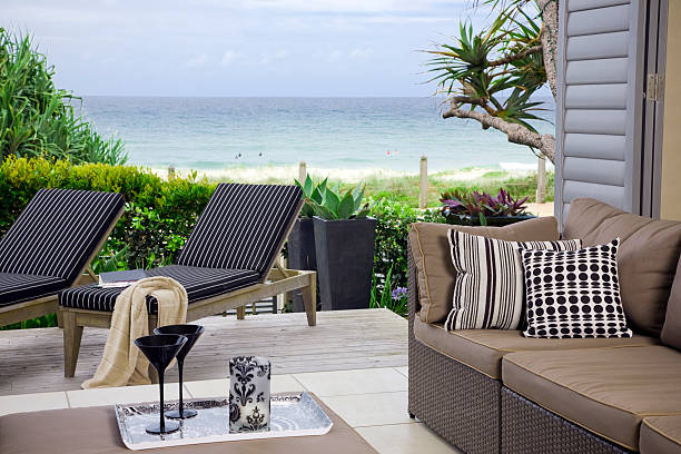 beautiful waterfront suite with ocean and beach views stock photo