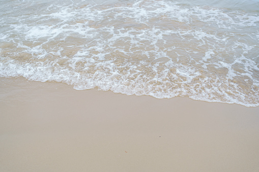 Beautiful wave water at white sand beach and crystal clear sea, Phuket, Thaiand