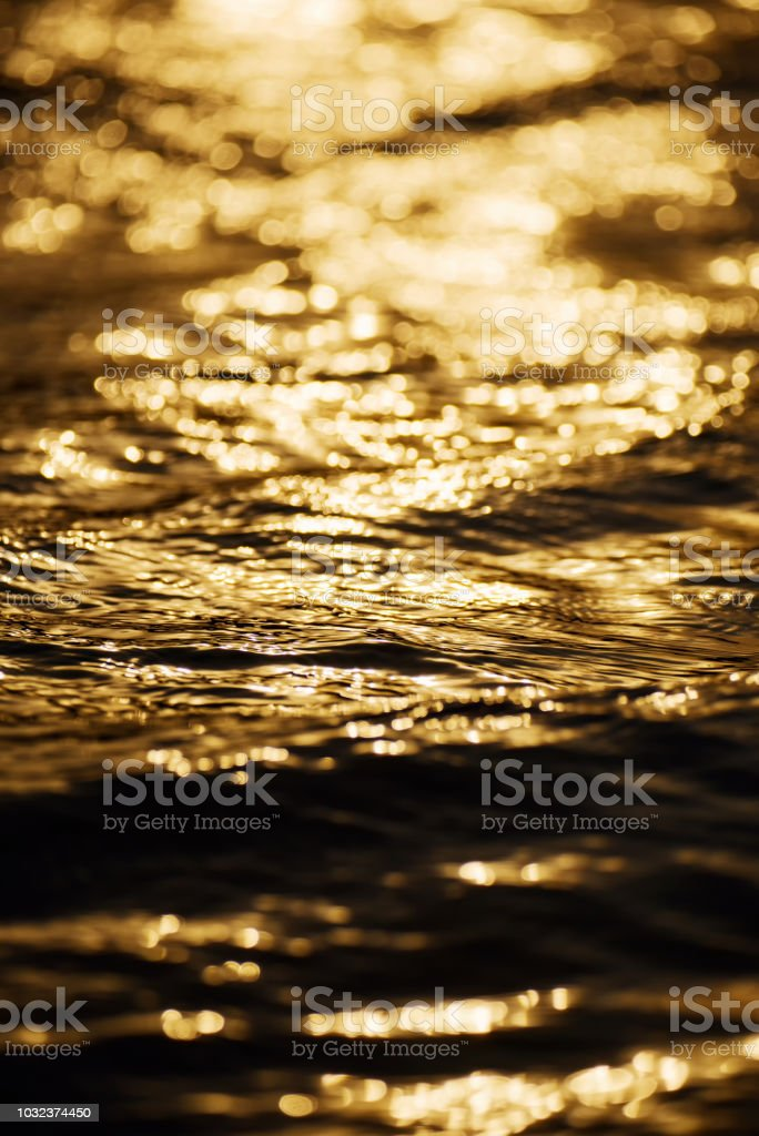 Beautiful waves at sunset close up stock photo