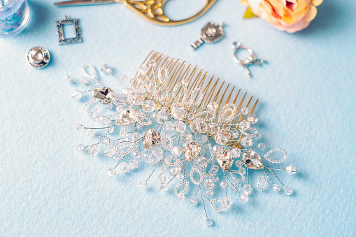 istock Beautiful wedding accessories and sewing accessories on a plain background, macro still life, items from the wedding salon 1153868370