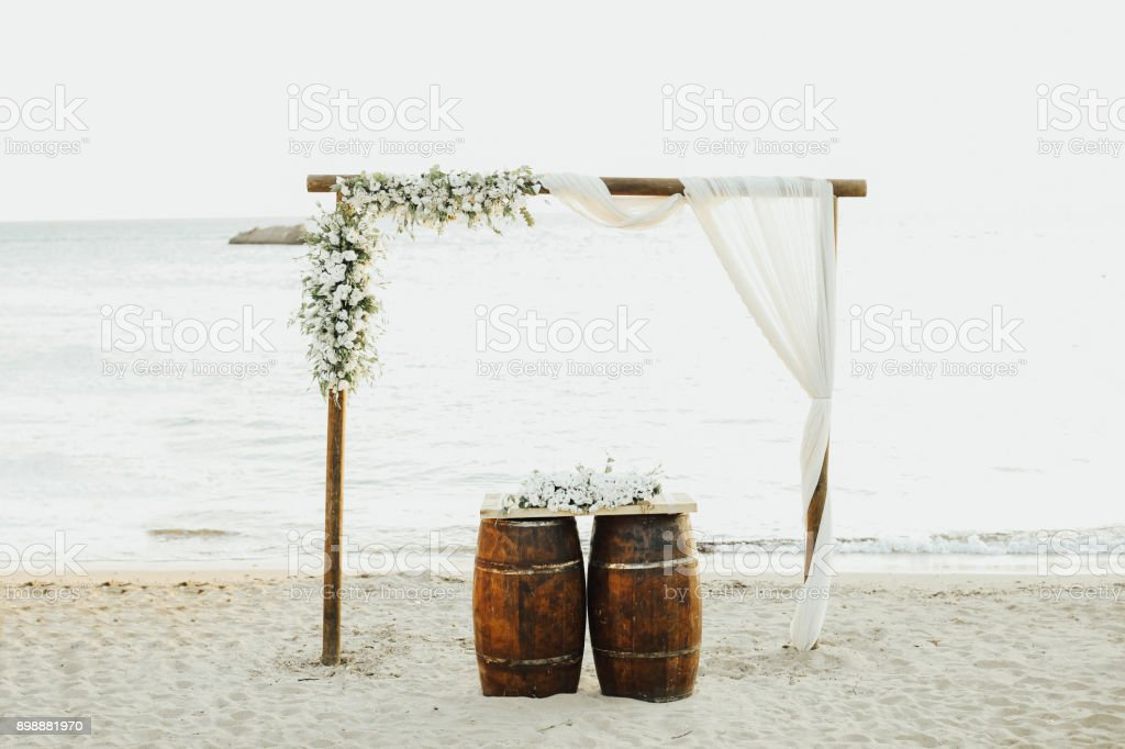 Beautiful wedding arch on the beach stock photo