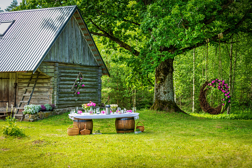 beautiful wedding banquet buffet table and decorations in rustic style in the country garden
