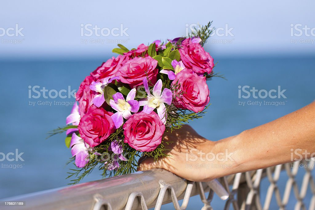 Beautiful wedding bouquet held by bride royalty-free stock photo