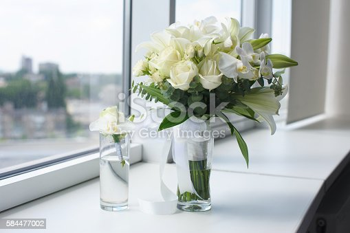 istock Beautiful wedding bouquet in a glass vase 584477002