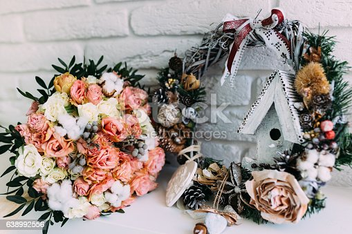 istock Beautiful wedding bouquet in winter styled interior close-up 638992556