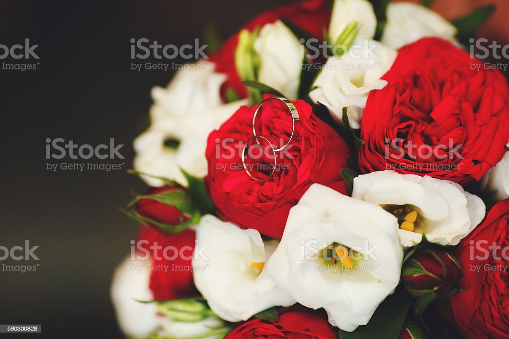 Beautiful wedding bouquet of red and white roses, selective focus Стоковые фото Стоковая фотография