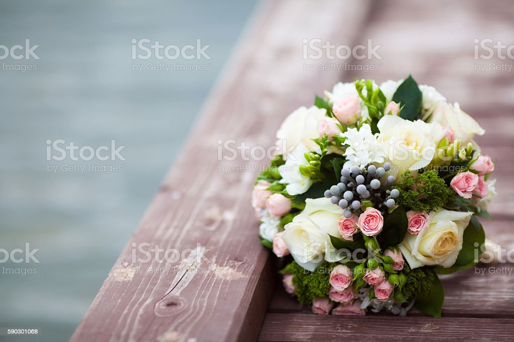Beautiful wedding bouquet on vintage wooden background. Marriage concept royaltyfri bildbanksbilder