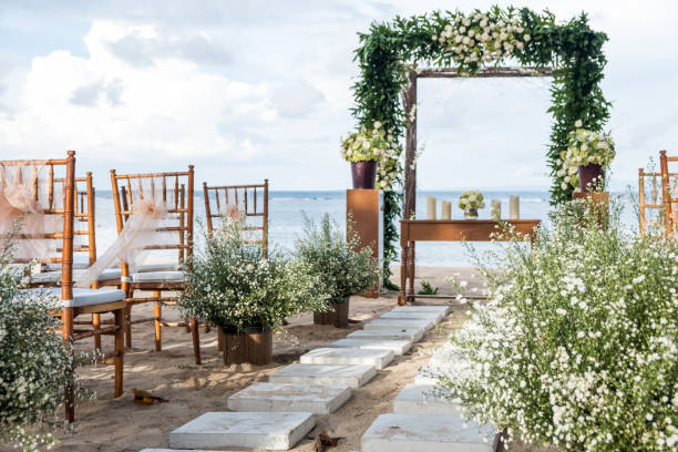 Beautiful wedding ceremony on the beach. Tropical exotic destination wedding concept Beautiful wedding ceremony on the beach. Tropical exotic destination wedding natural arch stock pictures, royalty-free photos & images