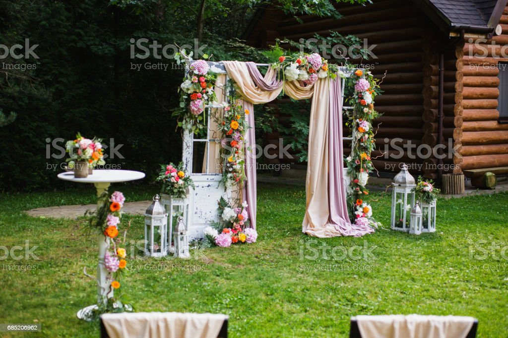 Beautiful Wedding Ceremony Outdoors Decorated Chairs Stand On The Grass Arch Made Of