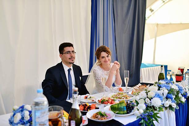 Beautiful wedding couple in restaurant stock photo