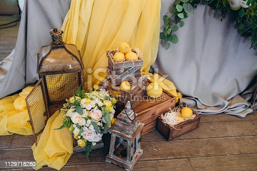 istock Beautiful wedding decor with flowers, lemons and candles 1129718280