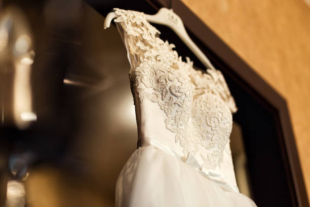 beautiful wedding dress hanging in the room, bridal accessories, wedding European, American Wedding stock photo