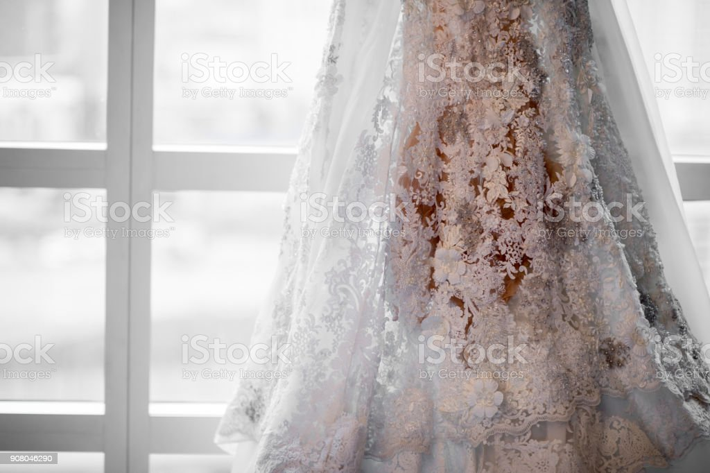 Beautiful wedding dress with window light stock photo