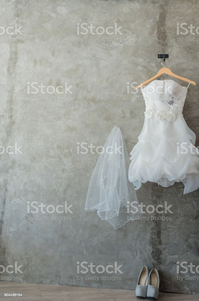 beautiful wedding dresses on a hanger stock photo