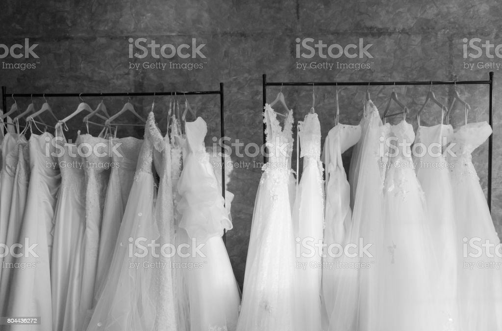 beautiful wedding dresses on a hanger stock photo