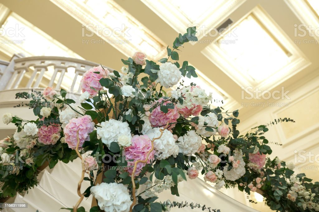 Beautiful wedding huppah decorated with fresh fresh flowers from...