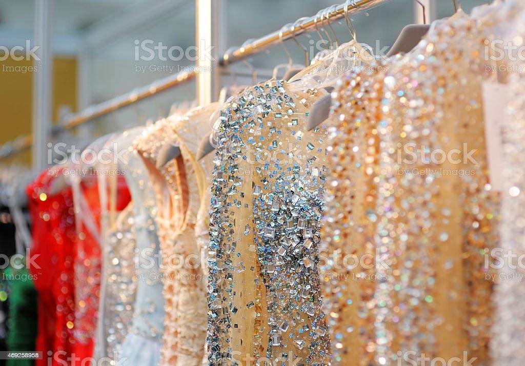 b823c9610b Beautiful wedding or evening dresses hanging on a rack royalty-free stock  photo
