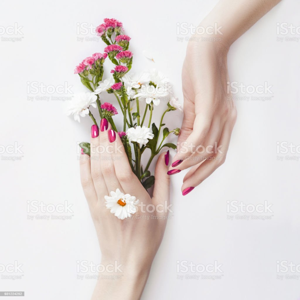 Beautiful wellgroomed hands with wild flowers on the table antiaging beautiful well groomed hands with wild flowers on the table anti aging and izmirmasajfo