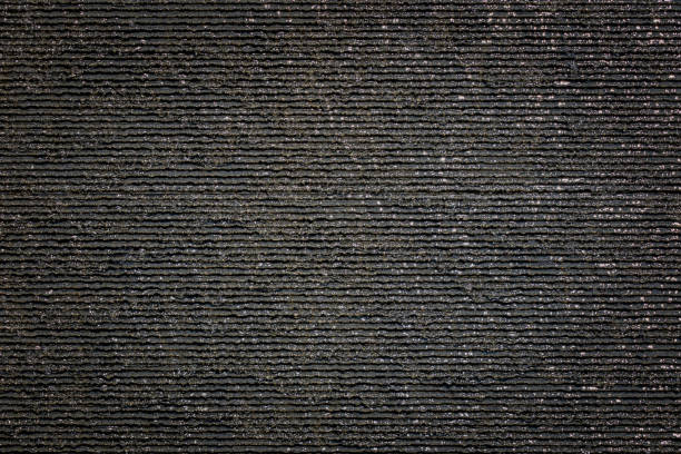 Beautiful wet black gray slate stone texture with water drops. stock photo