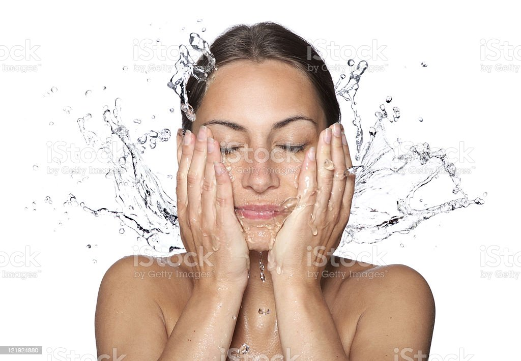 Beautiful wet woman face with water drop stock photo