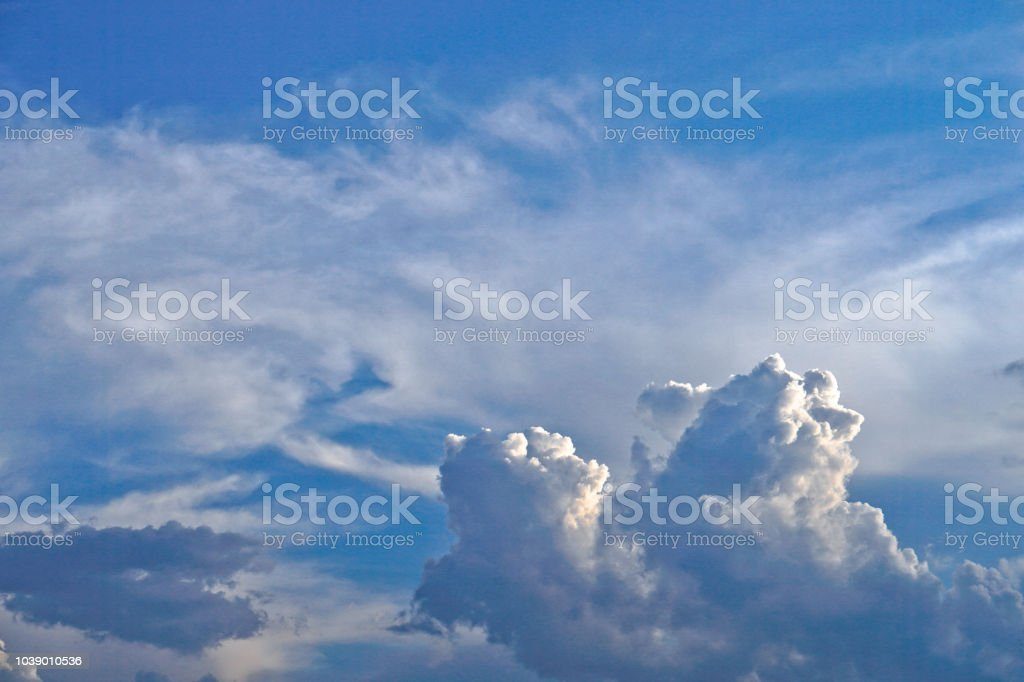 Beautiful white and gray clouds against the blue sky. Summer and...