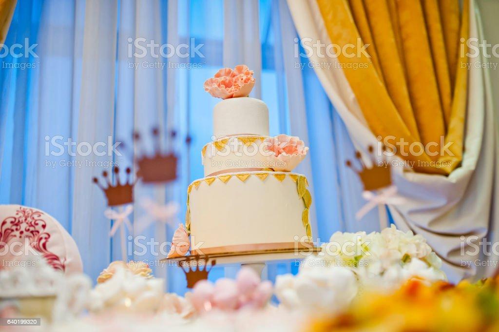 beautiful white big wedding cake with flowers stock photo