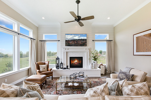 Beautiful white brick fireplace brings attention to a fabulous great room
