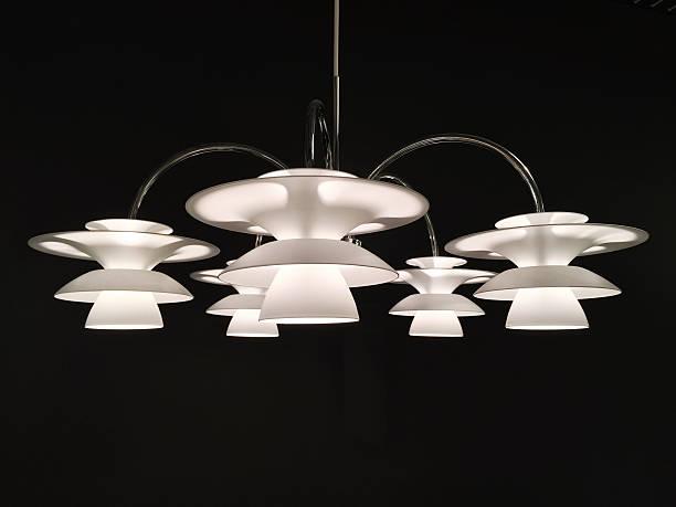 beautiful white chandelier on dark background - moderne 50er jahre mode stock-fotos und bilder